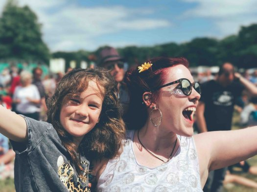 photo of mom and daughter at music festival by Annie Pratt in music festival survival guide blog