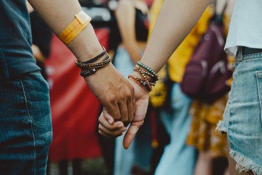 photo of holding hands at music festival for Music Festival 101 blog